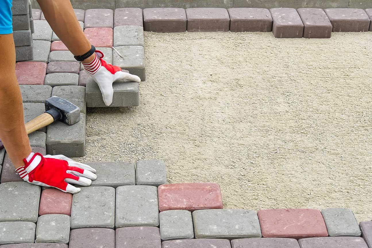 paving professional laying bricks